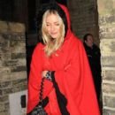 Sienna Miller bundles up in red as she leaves St. Pauls Church after attending a charity carol service with Jude Law