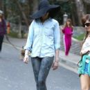 Anne Hathaway tries to hide her face under a big floppy hat while out for a walk with her husband Adam Shulman and friends in Los Angeles, California on December 29, 2013