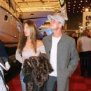DAVID COULTHARD British Formula 1 Racing Driver With girlfriend SIMONE ABDELNOUR Attending the London Boat Show - 454 x 695