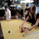 Axl and Ellen playing billiard