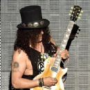Musician Slash of Guns N' Roses performs onstage during day 2 of the 2016 Coachella Valley Music & Arts Festival Weekend 1 at the Empire Polo Club on April 16, 2016 in Indio, California. - 437 x 600
