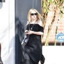 Dakota Fanning in Black Dress at Nine Zero One salon in West Hollywood - 454 x 636