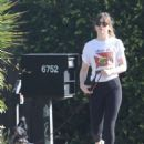Dakota Johnson in Tights with Chris Martin – Cruising in his golf cart in Malibu