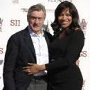 Robert De Niro and his wife Grace Hightower pose together at his hand and footprint ceremony at the TCL Chinese Theatre in Los Angeles on Feb. 4, 2013 - 454 x 595