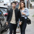 Joe Jonas and Blanda Eggenschwiler walk hand in hand after doing some book shopping at the Daily Planet Book Store in Los Feliz, California on November 20, 2013
