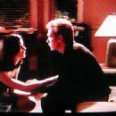 Linda Fiorentino and David Caruso in Jade (1995)