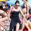 Candice Swanepoel in Black Swimsuit at the beach in Espirito Santo