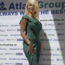 Pamela Anderson - Poses For Photographers In Budva, Montenegro, 15. 7. 2009.