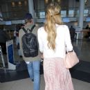 Paris Hilton and Chris Zylka at LAX Airport in Los Angeles - 454 x 588