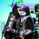Musicians Gene Simmons  and Tommy Thayer of KISS perform onstage during the 23rd Annual Race To Erase MS Gala at The Beverly Hilton Hotel on April 15, 2016 in Beverly Hills, California - 454 x 545