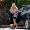Doutzen Kroes in a cropped top and denim shorts in Ibiza - 454 x 310