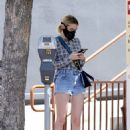 Emma Roberts – In denim shorts out for an iced coffee in Los Angeles