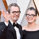 Gary Oldman and his wife Gisele Schimdt attends the 90th Annual Academy Awards at Hollywood & Highland Center on March 4, 2018 in Hollywood, California