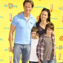 Steven and Julliette Weber pose for a picture with their kids