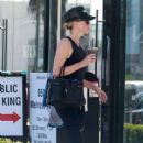 Charlize Theron in Tights – Heads at SoulCycle in West Hollywood