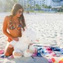 Claudia Romani – Bikini photoshoot on Easter Sunday in Miami - 454 x 303