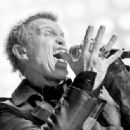 Recording artist Billy Idol performs onstage during the first ever iHeart80s Party at The Forum on February 20, 2016 in Inglewood, California. - 454 x 336