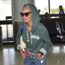 Kristin Chenoweth departing on a flight at LAX airport in Los Angeles, California on September 4, 2015 - 446 x 600