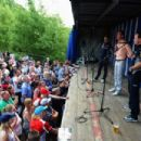 Infinti Red Bull Racing reserve driver Sebastien Buemi, former F1 driver David Coulthard and Infinti Red Bull Racing Team Principal Christian Horner talk to fans at a campsite appearance following qualifying for the British Formula One Grand Prix at Silve