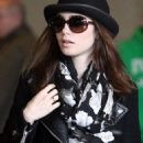 Lily Collins at Roissy airport in Paris (March 5)