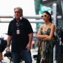 Nicole Scherzinger: walks in the paddock before the Malaysian Formula One Grand Prix at the Sepang Circuit in Kuala Lumpur