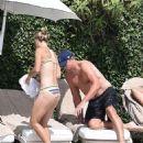 Caroline Wozniacki in Bikini on the pool in Portofino - 454 x 622
