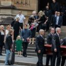 Angus Young at the funeral service for AC/DC co-founder Malcolm Young at St Mary's Cathedral on November 28, 2017 in Sydney, Australia - 454 x 373
