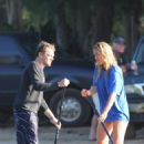 Bar Refaeli - Leonardo Dicaprio and his gf paddle surfing in Hawaii, 09.01.2011.