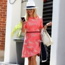 Reese Witherspoon is all smiles while leaving her office in Beverly Hills, California on July 12, 2016