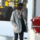 Milla Jovovich At Pearson International Airport in Toronto