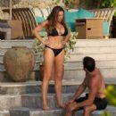 Kelly Brook in Black Bikini on the pool in Phuket