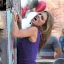 AnnaLynne McCord filming an action scene where she jumps into the back of a Taco Truck on the set of 90210 in Los Angeles,November 27, 2012