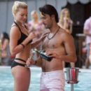 Margot Robbie and Rodrigo Santoro