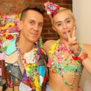 Miley Cyrus pose baskstage at Jeremy Scott fashion show during MADE Fashion Week Spring 2015 at Milk Studios on September 10, 2014 in New York City