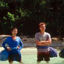 Francoise (Virginie Ledoyen), Richard (Leonardo DiCaprio) and Etienne (Guillaume Canet) ponder the distance they must swim in 20th Century Fox's The Beach - 2000