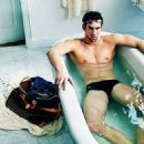 Leaving little to the imagination, a Speedo clad Michael Phelps soaks in a bath for his new ad campaign for Louis Vuitton