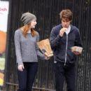 Emma Stone enjoyed a bite to eat as she strolled through Manhattan, November 15. She was accompanied by her boyfriend, Andrew Garfield