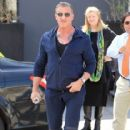 Sylvester Stallone poses with a group of fans while out running errands in Beverly Hills, California on March 28, 2017 - 416 x 600
