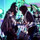Musicians Gene Simmons  and Tommy Thayer of KISS perform onstage during the 23rd Annual Race To Erase MS Gala at The Beverly Hilton Hotel on April 15, 2016 in Beverly Hills, California - 454 x 345