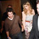 Nick Jonas and his girlfriend, Delta Goodrem, took in the Adele concert last night, August 17, in Los Angeles