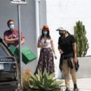 Ana De Armas – Looks cute in summer dress with Ben Affleck at Nick Fouquet hat shop in Venice - 454 x 303