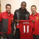 United front: Red Devils fan Bolt with Robin van Persie and Ryan Giggs