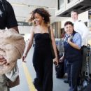Rihanna returns relaxed from her vacation in Hawaii at LAX in Los Angeles, CA on January 22, 2012