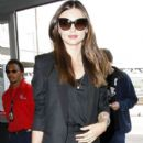 Miranda Kerr wears a rather baggy outfit as she arrives at the LAX Airport for a flight out of town