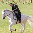 """Colin Farrell is seen riding a white horse on the set """"Winter's Tale"""" in New York City"""
