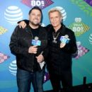 iHeart radio personnality Jay Towers poses with singer Billy Idol backstage during the first ever iHeart80s Party at The Forum on February 20, 2016 in Inglewood, California. - 416 x 600