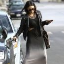 Vanessa Hudgens hides her face as she stops by a studio in Santa Monica, California on February 8, 2014
