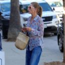 Rebecca Gayheart in flared denim pants out in Los Angeles - 454 x 681