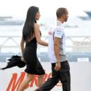 Nicole Scherzinger and her boyfriend Lewis Hamilton walk hand in hand as they attend the Amber Lounge Fashion Show and Charity Auction at The Beach Plaza Hotel