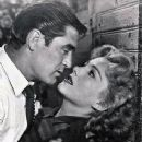 Anne Baxter and Steve Cochran